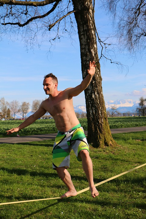 Man in Beach Shorts Slacklining