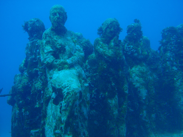 Visiting underwater statue while snorkeling at the Museo Subacuático de Arte in Cancun Mexico